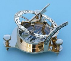 Sundial with magnetic compass