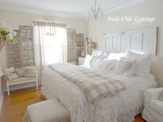 Serene White Guest Cottage Bedroom-love lamp, sign & vintage mailbox on door