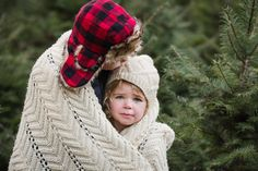Family Christmas photo shoot done at Allouette Tree Farm by Paraphrase Productions. Includes beautiful holiday photographs amongst the evergreen trees.