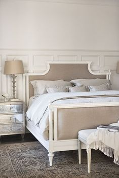 Beautiful Nantucket style master bedroom with painted paneling.