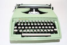Vintage Green Remington Holiday Portable Typewriter.