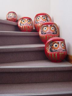 Japanese Daruma traditional doll. The eyes of Daruma are often blank when its sold. The recipient of the doll fills in one eye upon setting the goal, then the other upon fulfilling it. In this way, every time they see the one-eyed Daruma, they recall the goal.