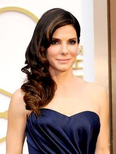Sandra Bullock glamorous side-swept curls, subtle smoky eye with pink lipstick | allure.com