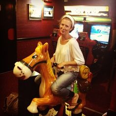 Just cuz... this is a silly photo of a girl on a coin operated horse in France