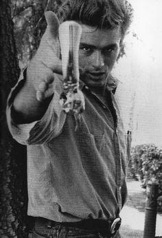 James Dean with a revolver, dapper as ever