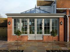 Orangery with brick corners, roof lantern and matching doors / windows. Orangery with brick corners, roof lantern and matching doors / windows. Orangery Extension Kitchen, Orangerie Extension, Kitchen Orangery, Orangery Conservatory, Conservatory Extension, Kitchen Diner Extension, Orangery Roof, Conservatory Ideas, House Extension Design
