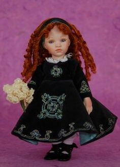"""""""Kathleen Irish Dancer"""" (Dolls by Pauline Bjonness-Jacobsen)  -  Kathleen is dressed in her traditional Irish dancing costume! Her delicate features & beautiful blue eyes are framed by glorious curly red hair. Her dress is made w/ a luxurious green velvet & features stunning Celtic embroidery & cotton lace trim. Kathleen also wears a pretty yellow tulle petticoat & delicate dancing shoes w/ long lace tie-ups. She holds a beautiful bouquet of white flowers. Limited Edition of 1000 worldwide."""