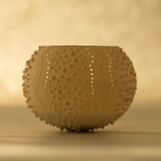 Porcelain Ceramic Urchin Candle Holder  - this is totally what I have been trying to do, but failing.  Wow