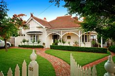 Traditional Exterior by Pasco Design | Federation style weatherboard. Federation-style architecture flourished during the budding national identity in the late 19th and early 20th centuries. Architects and builders fused influences from France, Britain and America to create a uniquely Australian style – less formal than its Victorian predecessors and far better suited to the country's subtropical climate.