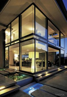 Love the use of light, the floor to ceiling windows and the black fames. Very classy! -- Montrose House by SAOTA --