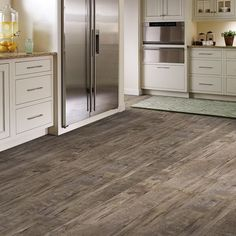 Laminate floors are not like they used to be! Using the latest in technology these laminate wood look floors are a smart choice for high traffic areas when affordability is also a factor. Soft under foot yet durable and incredibility realistic. Shop the Mannington Resoration Laminate Floor Collection in a wide range of colors and textures.