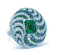 TIFFANY & CO. 2016 BLUE BOOK COLLECTION ~ Ring of an emerald-cut emerald with round blue sapphires, tsavorites and diamonds.
