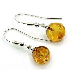 'Golden Sun Drops' Sterling Silver Natural Baltic Amber Dangle Earrings  Price : $27.95 http://www.silverplazajewelry.com/Golden-Sterling-Silver-Natural-Earrings/dp/B00GTQGUS0