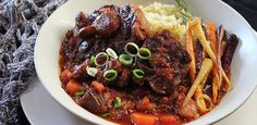 Fall-off-the-bone Oxtail. Garlic herbs and red wine with succulent pieces of oxtail slow cooked in this aromatic sauce served with smashed cauliflower and carrots. Oxtail Recipes, Beef Recipes, Soup Recipes, Big Meals, Easy Meals, Smashed Cauliflower, Gluten Free Wine, My Favorite Food, Favorite Recipes