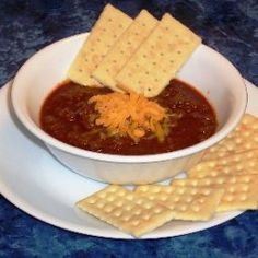 "This recipe is similar to, and based on the 1994 champion's recipe of the Terlingua chili cookoff. http://www.chili.org/recipes.html. I learned a lot studying the website and hopefully, you'll check it out, as well. Evidently, the secret to good chili is ""layering"" the flavor. There are no beans in ""real Texas chili"", but I've tried it with and without beans and it's great either way. Set aside at least 3 hours for this, and if you have leftovers, it freezes well.  - Terlingua Chili"