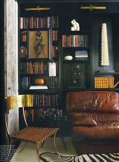 Masculine black bookshelves via Elle Decor