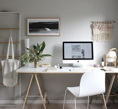 Sometimes simple office decor is the best. I love the rack for placing bags and scarves, and the macramé on the wall. So simple, so calming.