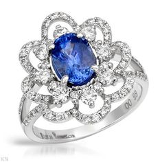 Cocktail ring with genuine sapphire and diamonds.