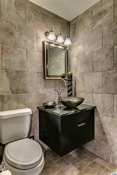 Eclectic Powder Room with Complex granite counters, Powder room, Pedestal sink, limestone tile floors, High ceiling
