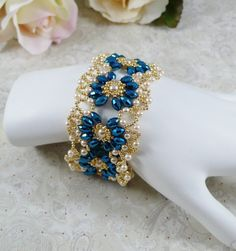 Woven oval pearl bracelet in metallic blue.     There are hours of work in this piece but it was worth it. Its the perfect combination of delicate