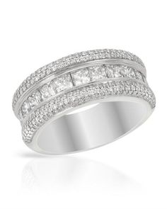 Princess cut diamonds in white gold. This ring is really stunning!