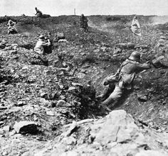 Holding the line: German soldiers taking cover in shell-holes gun down charging French soldiers during the Nivelle Offensive.
