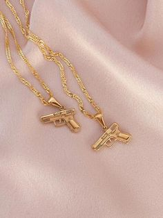Gold Filled Gold Gun Necklace DESCRIPTION Gold Filled Pendant Pendant: Chain Length: Gold Plated Chain Imported Recommend to keep jewelry away from water. Keep Jewelry, Cute Jewelry, Jewelery, Silver Jewelry, Jewelry Accessories, Jewelry Necklaces, Gold Bracelets, Diamond Earrings, Jewelry Ideas
