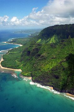 The stunning Na Pali coast as seen from a helicopter coming around to Haena Point and Ke'e Beach with Hanalei Bay beyond.