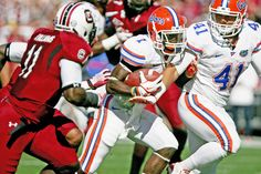 Florida Gators running back Chris Rainey (1) rushes for a gain as South Carolina Gamecocks safety Brison Williams (11) pursues in the first half at Williams-Brice Stadium.