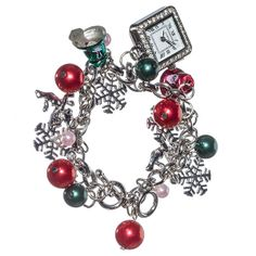 Silver toned charm bracelet with red and green beads, snowflake charms, bell charms, and a dangling silver toned watch charm