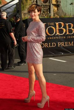 Evangeline Lilly great legs, not so great hair, on the New Zealand Hobbit red carpet in a mini dress and towering high heels