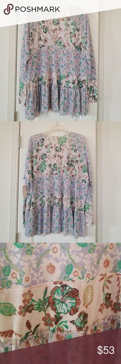 Free people blouse Multi color light waight fabric, sheer super cute and soft NWT. Free People Tops Tunics