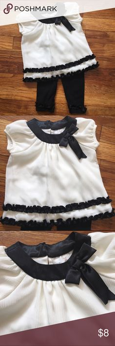 🌙DONATING SOON🌙 Cute Dressy Outfit for Baby Girl This is an adorable two piece outfit for baby girl. Top is offwhite with black satin trim and ruffles. Pants are black with ruffles at ankle. Must have! Bundle and save! Pet free and smoke free home. Rare Editions Matching Sets