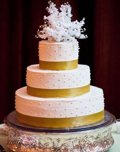 Pretty gold and white cake on the Wedding Channel
