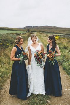 Bridesmaids wear long navy blue dresses    Photography by http://www.alexdefreitas.com/