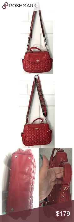 Rebecca Minkoff Casanova Leather Satchel Purse Bag Red leather Rebecca Minkoff Handbag Satchel purse with golden spikes & hardware. In very nice preowned condition, I don't have the original detachable shoulder strap, so it includes 1 matching gold tone & red leather attachable strap & 1 silver tone guitar strap boho style attachable strap. Cheetah print interior in great condition. Rebecca Minkoff Bags Satchels