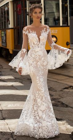 6e2f56d1c Want this gorgeous wedding dress! Tarik Ediz bridal gown with long lace  bell sleeves #