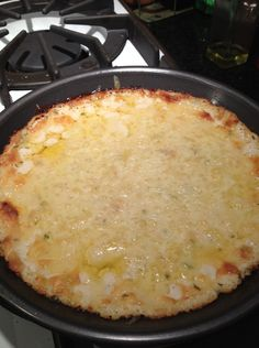 Roasted Garlic and Asiago Dip. Serves 10-12 as an appetizer. 2 whole heads of garlic; 2-3 T olive oil; 8 oz cream cheese, whipped is preferable; 4 oz Asiago cheese, shredded; 1/2 cup sour cream; 6 T heavy cream; small handful fresh flat leaf parsley, chopped finely; pinch each of kosher salt & freshly ground black pepper; 2 oz mozzarella cheese, shredded.
