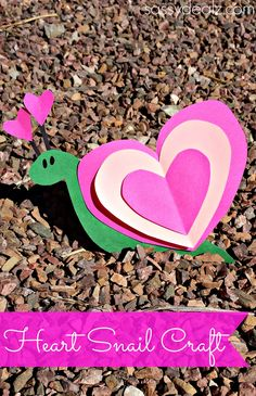 You will need pink,/green/black construction paper, scissors, a black marker, and glue to make this cute heart snail! valentine heart snail craft Cut out three hearts that can fit inside one another. Then cut two small hot pink hearts and two black lines. Glue the hearts to the back of the snails green body. snail heart craft for kids Glue the hearts on the head and add eyes with a black sharpie! There you have a Valentine snail art project :)