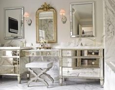 Designer Carrie Hayden took the homeowners' bedroom dressers and connected them with a mirrored vanity table for a glamorous bathroom interior design decorating before and after designs Mirrored Vanity Table, Mirrored Bedroom Furniture, Bedroom Dressers, Mirror Bedroom, Furniture Sets, Mirrored Dresser, Furniture Vanity, Bathroom Furniture, 1920s Furniture