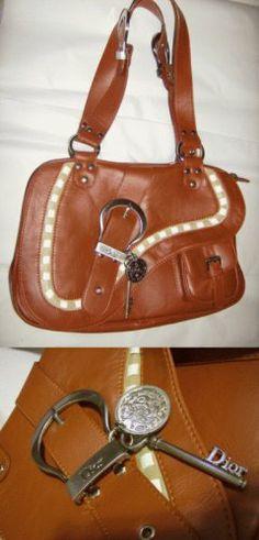 Christian Dior Saddle Bag null,http://www.amazon.com/dp/B000N3PZQS/ref=cm_sw_r_pi_dp_CL2jtb0NDDGCG3DD