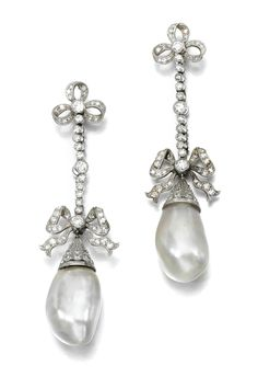 Pair of pearl and diamond earrings, early 20th century. Each designed as a line of millegrain collet-set circular-cut diamonds between trefoil and bow motifs, suspending a pearl drop