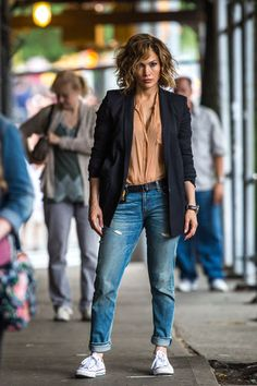 While filming 'Shades Of Blue' in 2015, J.Lo modeled boyfriend jeans, sneakers and a blazer.