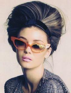 brown with silvery blonde highlights, orange cat sunglasses, pink lips, black headband. LOVE