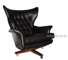 From GDUKStyle.com Retro feature: G-Plan Armchair in Black Leather POA from www.inmyroom.co.uk.