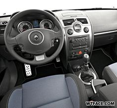Two for the price of one… Steering wheel with a totally sunny disposition right next to a menacing dash console…