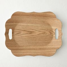 """Vividly printed wood veneer adds natural appeal to this striking tray with a romantic, scalloped edge.- Plastic, wood veneer- Decorative use only; not food safe- Wipe clean with damp cloth- Imported1""""H, 16.5""""W, 12.75""""L"""