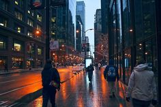 A cold winter rain slicks streets and sidewalks in the Chicago Loop