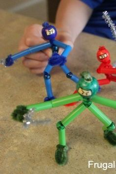 Making ninjas with pipe-cleaners and straws for little boys