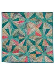 Grab 16 fat quarters, and you are on your way to a wall quilt with a twist!